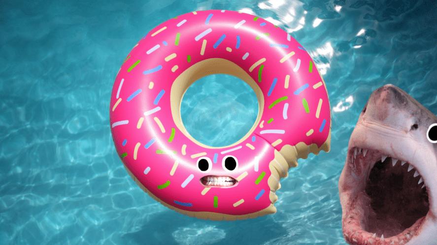 A shark biting a pool float