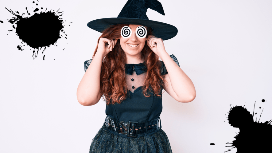 Woman dressed as a witch on white background