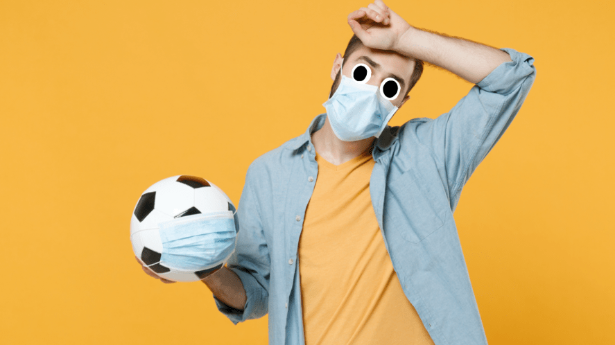 a football wearing a face covering
