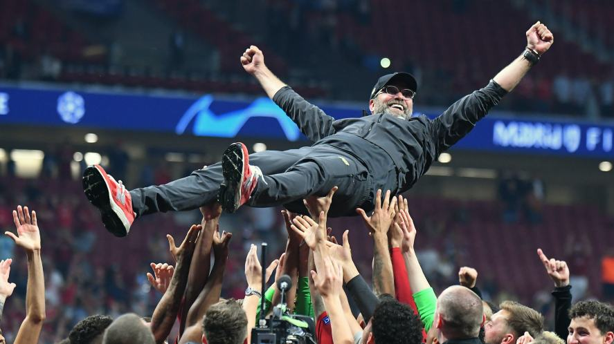 Liverpool manager Jurgen Klopp is thrown in the air after the award ceremony held after the 2018/19 UEFA Champions League Final.