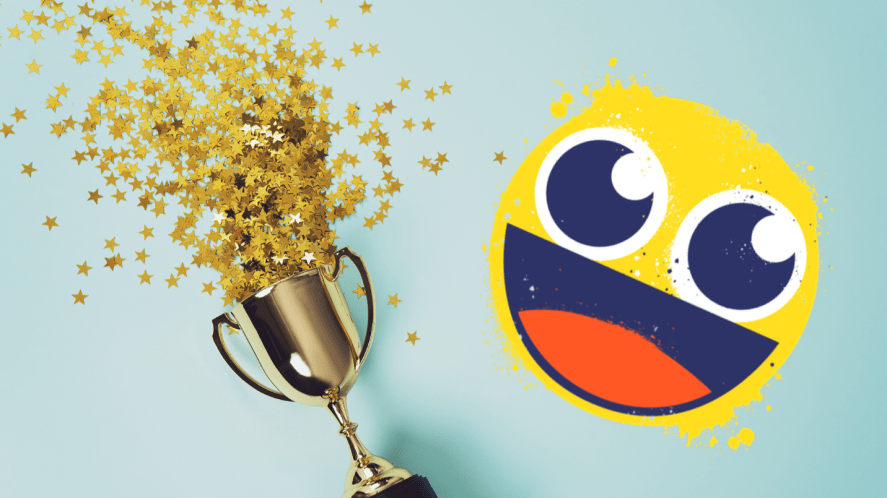 Trophy and sequins on blue background