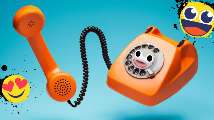 An old phone and happy emojis