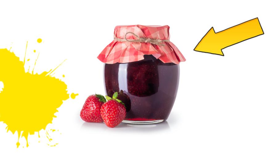 Jar of jam on white background