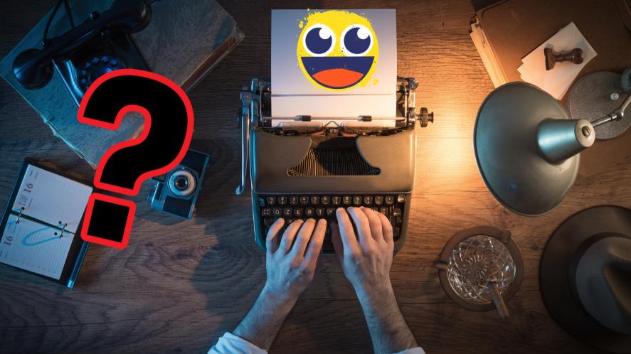Hands typing on typewriter on desk