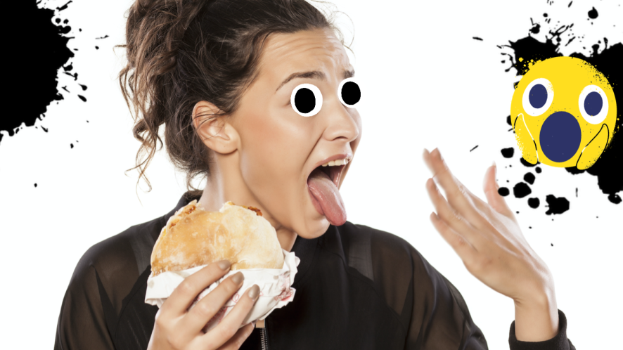 A woman eating a hot spicy snack