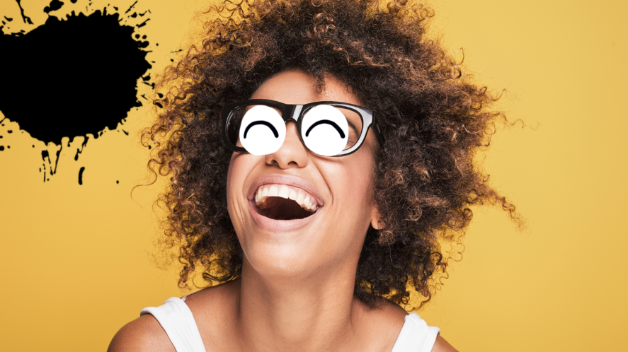 Woman laughing on yellow background