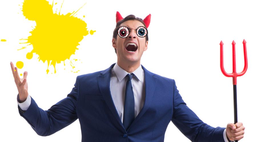 Man dressed as devil on white background