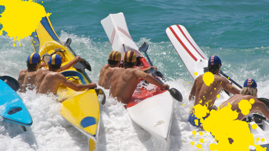 Athletes in the sea with canoes