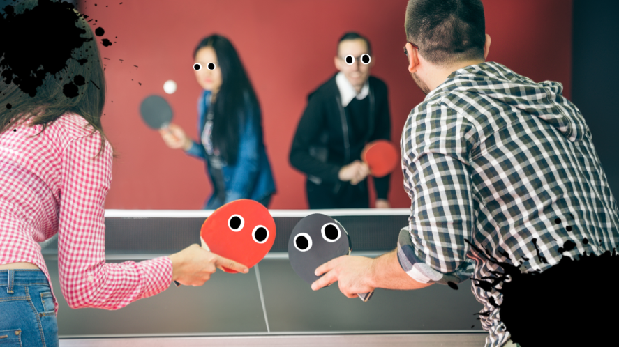Group playing table tennis