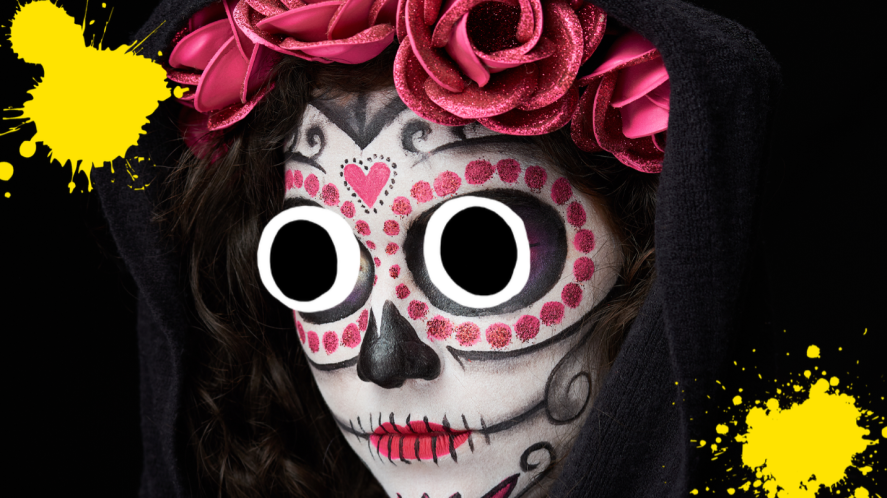 Woman on black background with Catrina style face paint