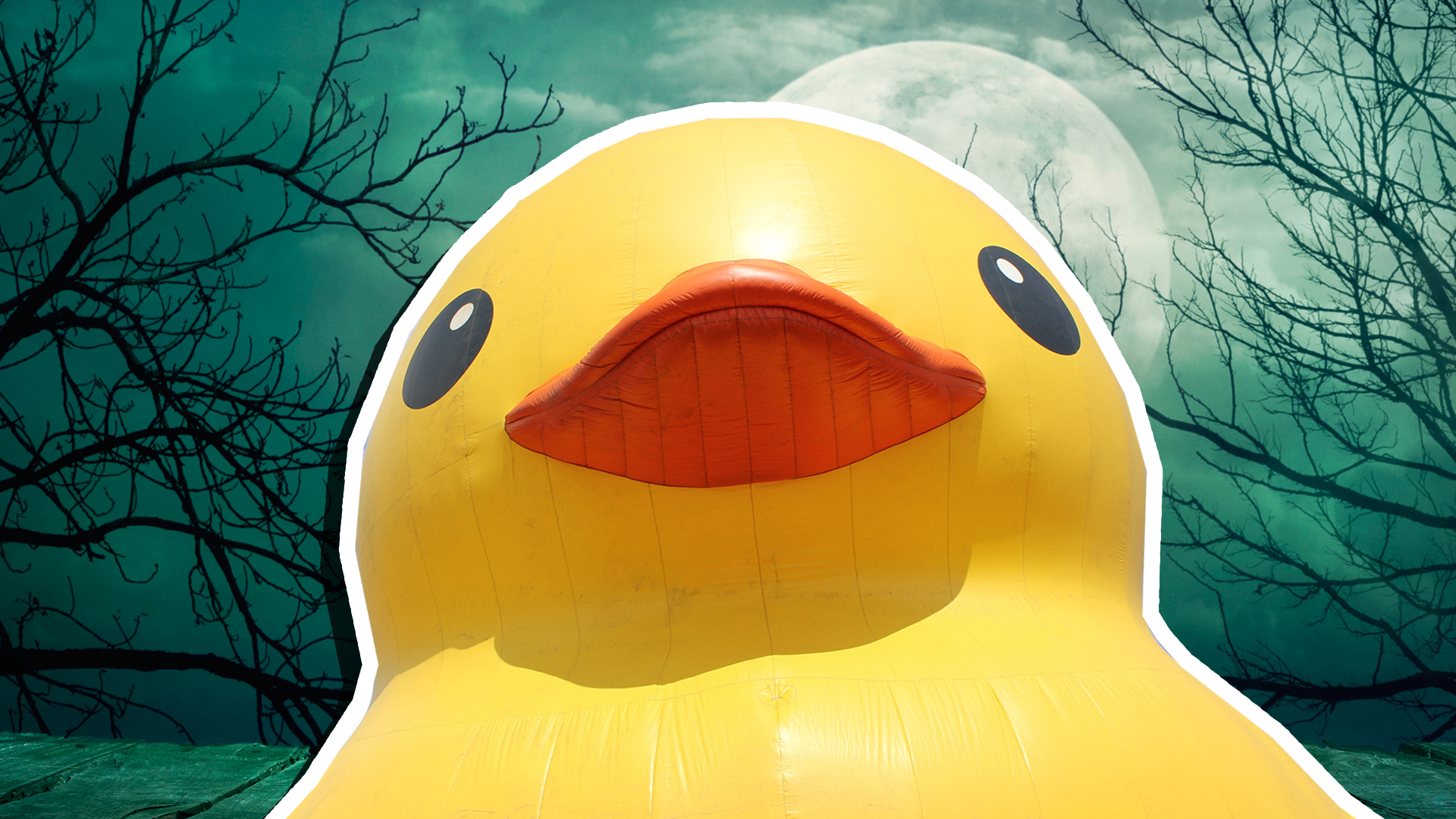 Large yellow inflatable duck in front of a full moon