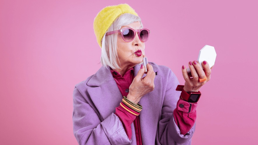 Older woman trying on clothes and makeup
