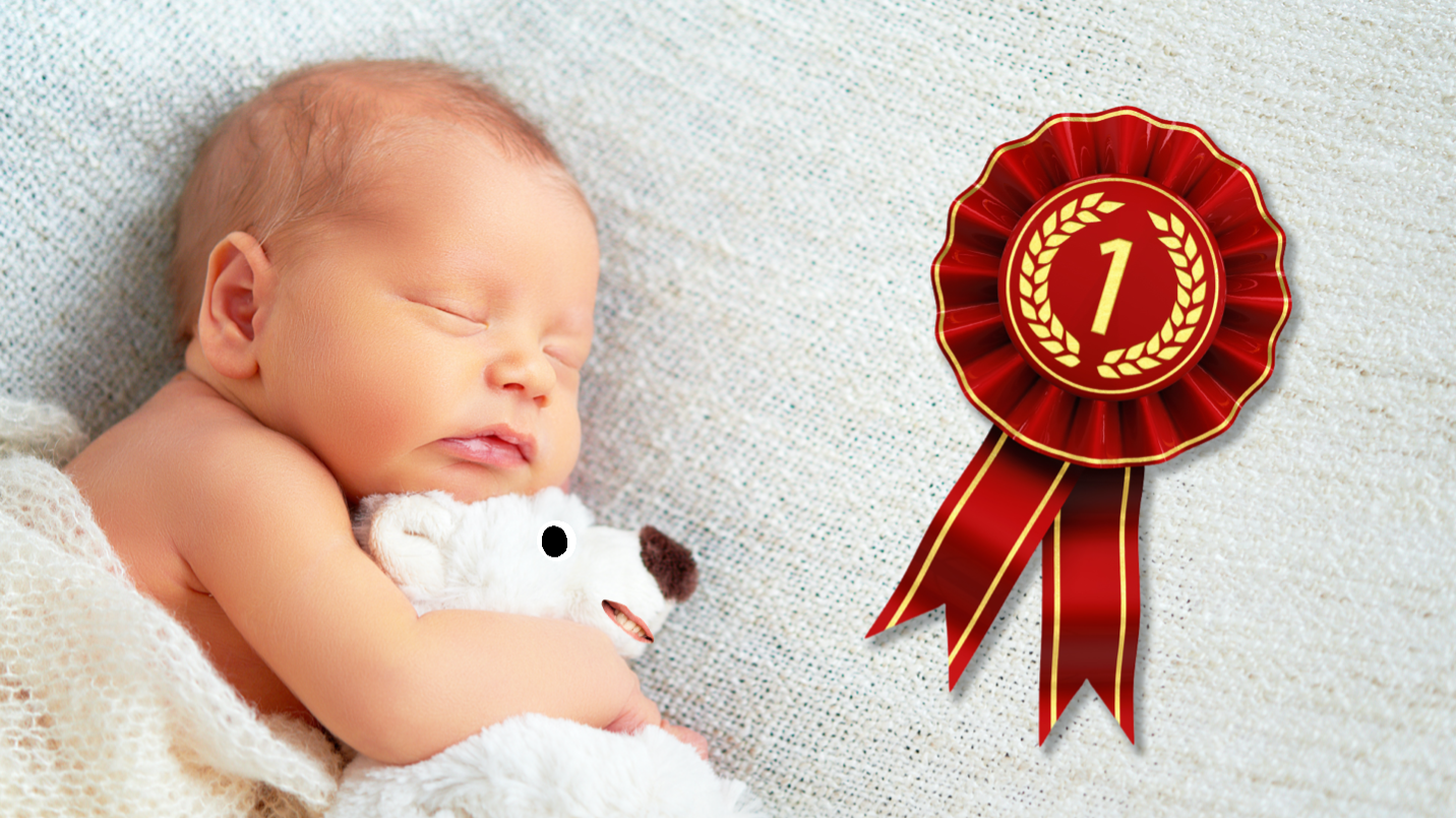 A baby with a first place rosette