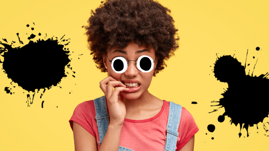 Woman looking nervous on yellow background