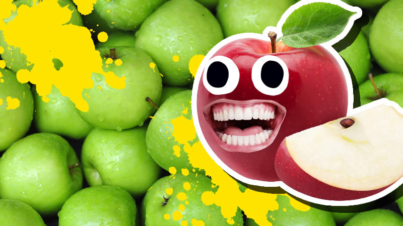 A smiling red apple in front of lots of green apples