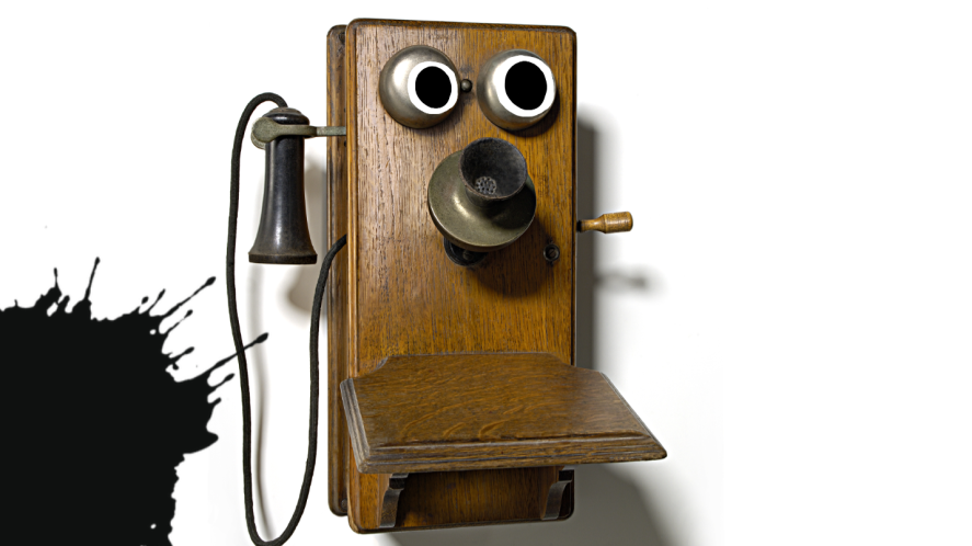 Old telephone with googly eyes