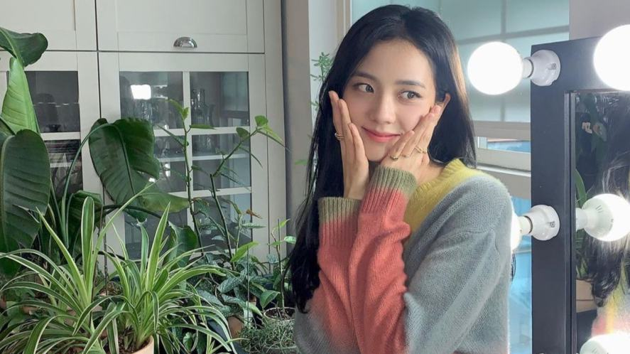 Jisoo in a kitchen surrounded by plants
