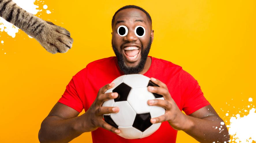 A football fan holding a ball