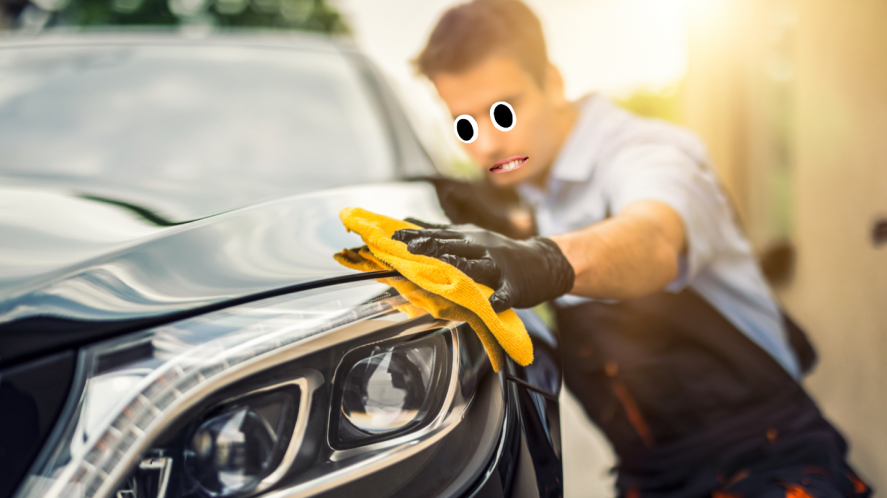 A man polishing a new car