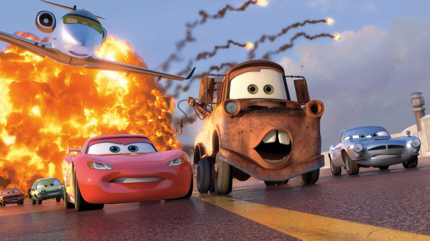 Lightning McQueen and Mater driving away from explosion