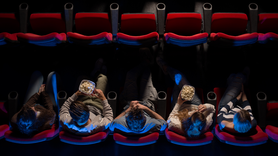 People in a cinema eating popcorn