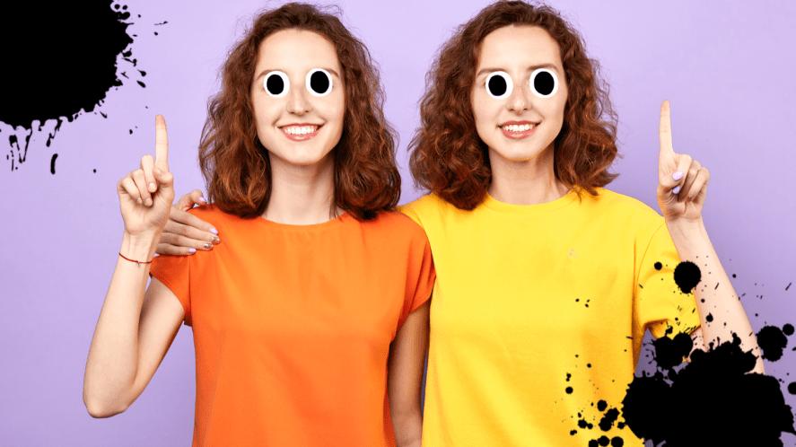 Twin girls on purple background
