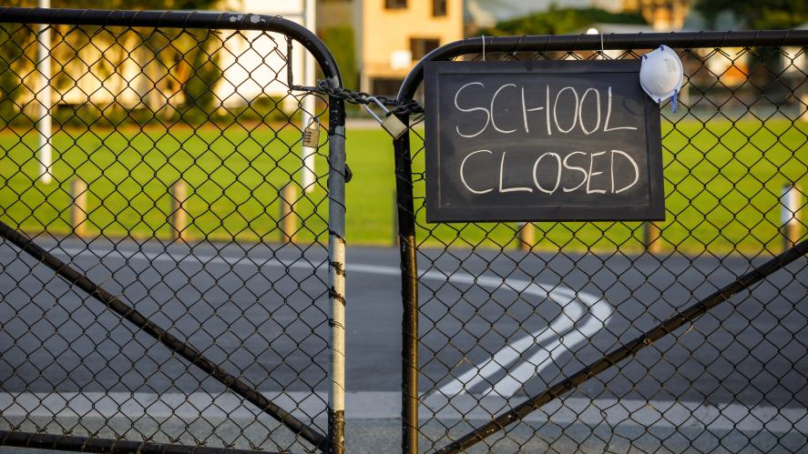 A school with a closed sign