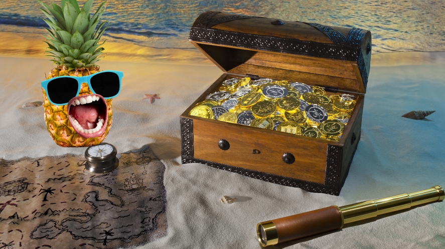 Treasure chest and map on beach