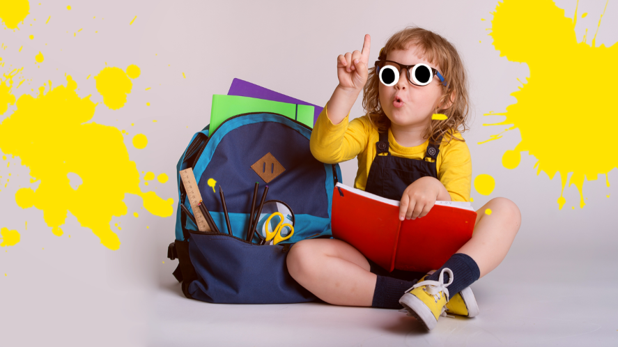 Girl on grey background with school supplies